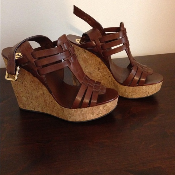26d42f1fd6006 Tory burch Leslie brown strappy cork wedges. M 55c0fca916ba97161402020b