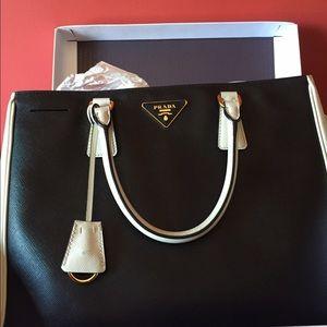 Brand-new in box never been used Prada bag