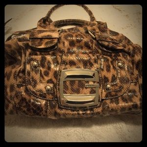96ae71da68 Guess Bags - Leopard print Guess purse from Macy s.