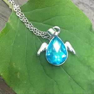 Beautiful and dainty blue winged necklace