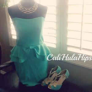Turquoise Peplum dress! M from Andin\'s closet on Poshmark