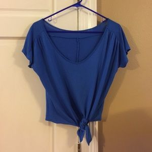 Royal blue short sleeve crop top with tie bottom.