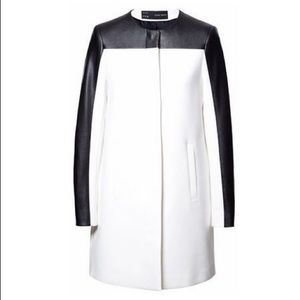 Zara white coat with black leather sleeves