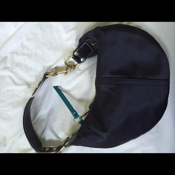how to clean a satin coach purse