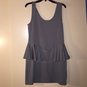Grey, fitted dress with peplum accent.
