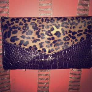 Dark brown and leather clutch
