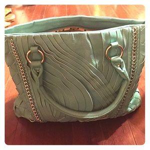 Light turquoise vegan leather handbag.