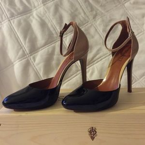 Schultz Black and Tan pointed toe high heels