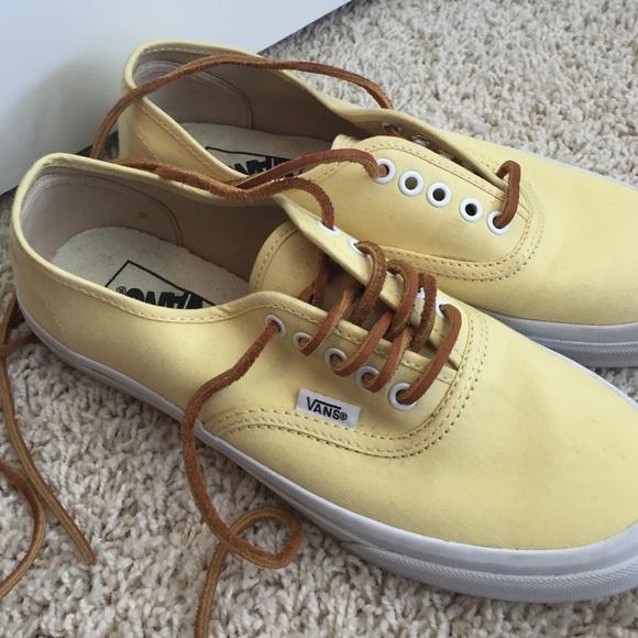 beige vans with brown laces