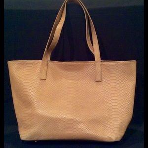 Tan alligator design purse