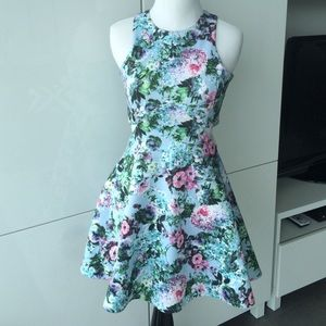 Flirty floral dress with cut outs!