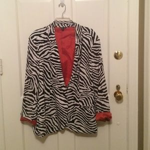 Leopard polyester / spandex  lined jacket.