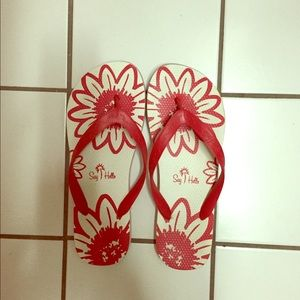 New red and white flip flops