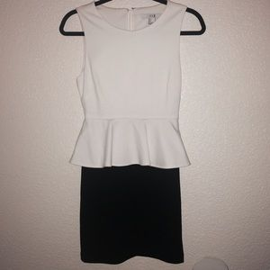 White and black peplum dress