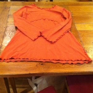 Long sleeve orange dress.