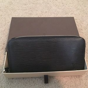 LOUIS VUITTON Epi leather zippy wallet