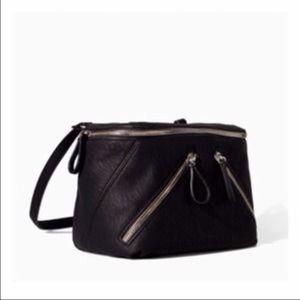 Black Zara handbag with diagonal zippers.