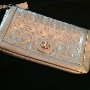 COACH rose metallic wristlet