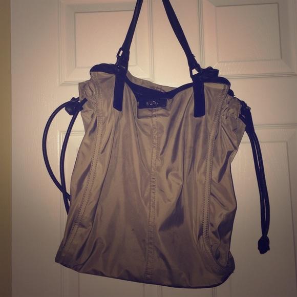 716cc052588e Burberry Handbags - Burberry nylon buckleigh tote
