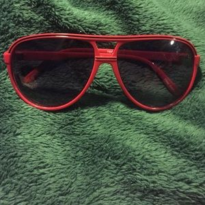 Accessories - Red oversized sunglasses.