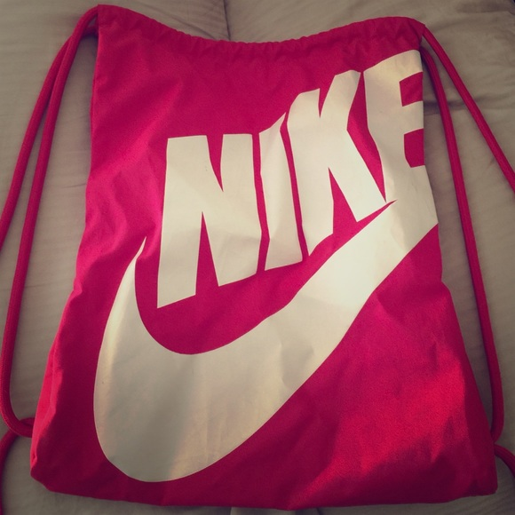 73% off Nike Handbags - Hot pink Nike drawstring bag from Emily's ...
