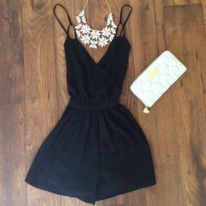 Adorable, black romper with an open back