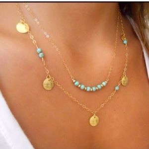 Double strand necklace.