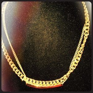 NEW LISTING gold toned chain/bar necklace
