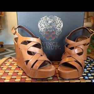 Never worn natural leather wedge platform shoes.