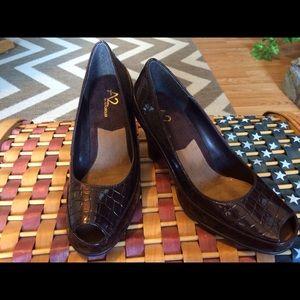 Areoles 2 open toe croc print pumps.