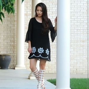 Dresses & Skirts - Black tunic dress with bell sleeves