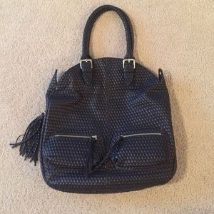 Carla Mancini Brown leather handbag.