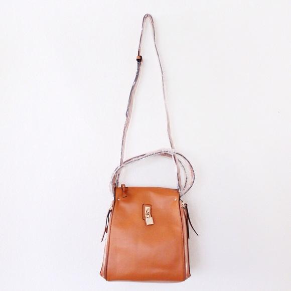 34ff5f5e8fe4 Burnt Orange Zipper Padlock Sling Bag