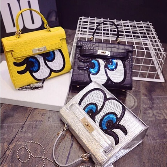 c54cf550fd10a Handbags - Korean unique yellow big eyes kelly style bag