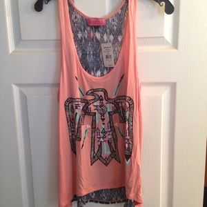High/low tank top with sheer back.