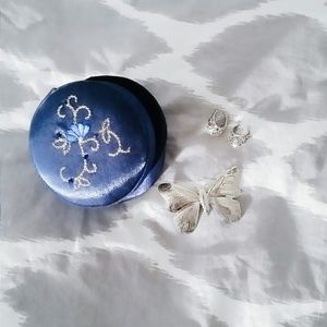 Dark blue fabric jewelry box.