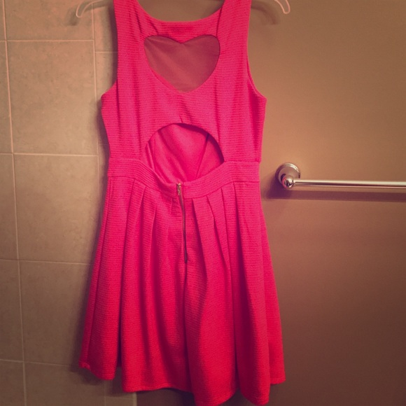 c92194f390 LAMOUR pink skater dress with heart shaped back. M 55dd0d6477adeaff21000b60