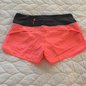 Lululemon 6 - neon coral run speed 4 way shorts