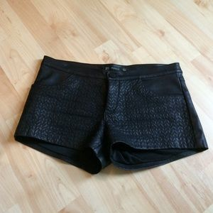 Black faux leather quilted shorts