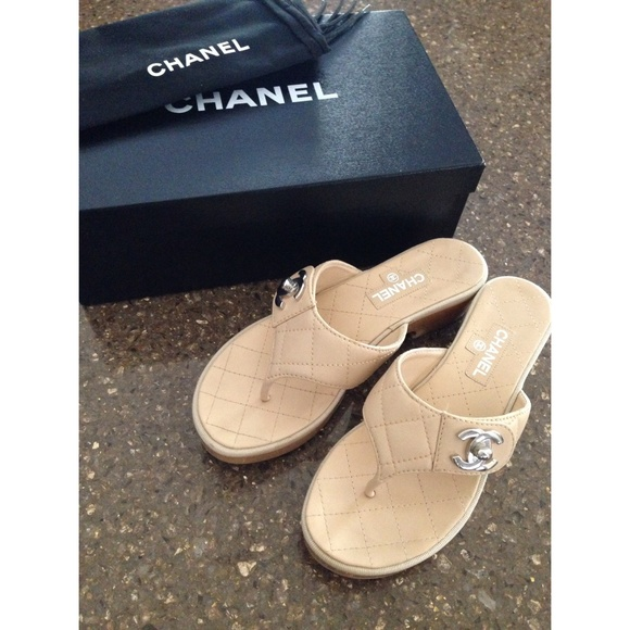 bd4100221 CHANEL Shoes - CHANEL CC Logo Quilted Thong Sandals in Beige