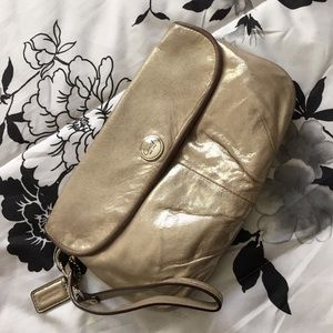 Coach gold large leather flap wristlet