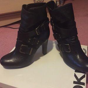 Black leather platform boot with bronze straps
