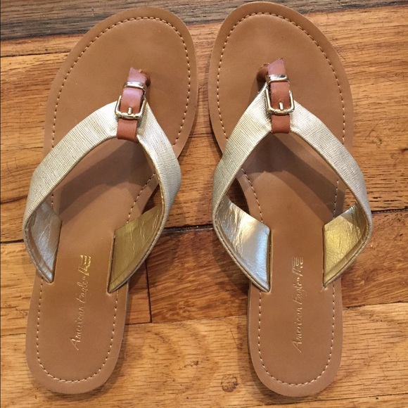 68fd03f11f3191 American Eagle by Payless Shoes - Cute gold buckle flip flops size 5