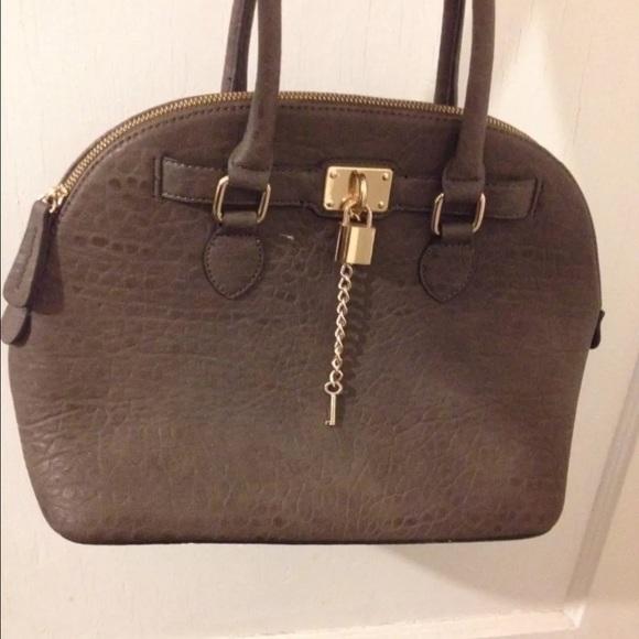 f380974265a ALDO Handbags - Aldo brown satchel hobo handbag lock   key gold