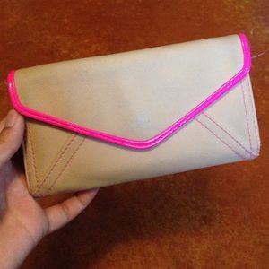 Tan and pink wallet