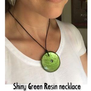 Shiny Green Resin Pendant on waxed cord