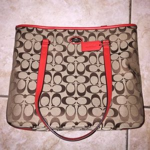 A red trim coach bag