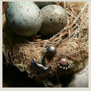 Tiny bird with nest and pink pearl necklace
