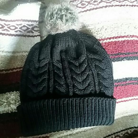 c1b80f6c4a8 Black knitted beanie with fur ball on top. M 55eb07b4ea3f36e76300b9bf.  M 55eb07b4ea3f36e76300b9bf