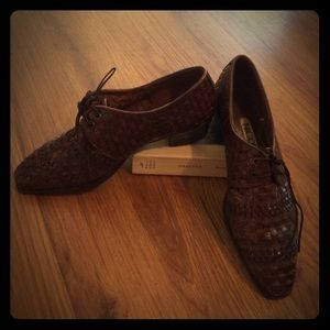 Brown woven Oxford with 1 inch heel.